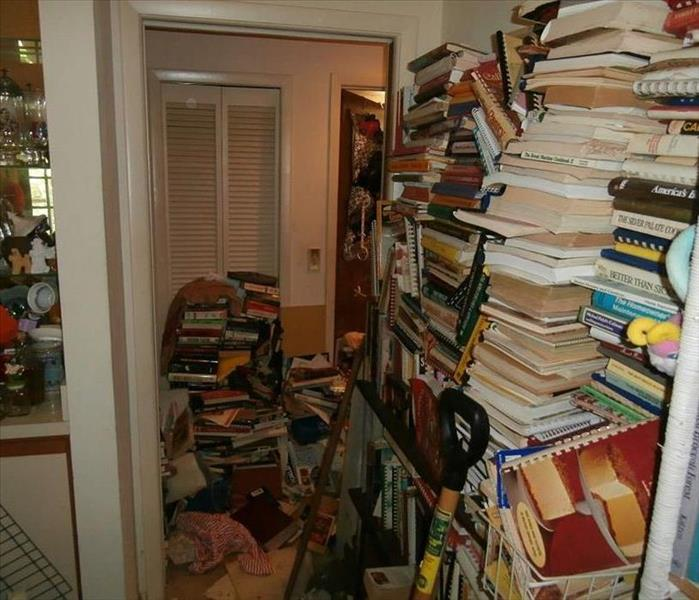 Stacks of books in a hallway