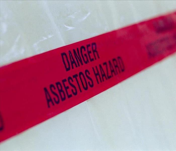 Red asbestos hazard warning tape