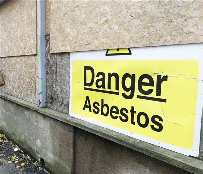 Asbestos Danger Warning Sign at House Site