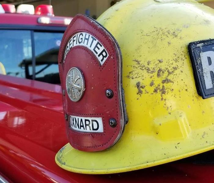 fire safety near me - image of yellow firefighter helmet
